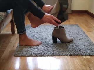 Wearing sexy boots and walking on the carpet