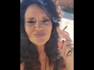 Mature mom smokes 1st joint of the day w/ footplay