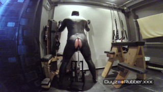 Guy in shiny rubber is bored during lockdown and finds different toys to fuck his hole with