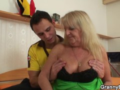 Hairy blonde granny in stockings rides strangers cock