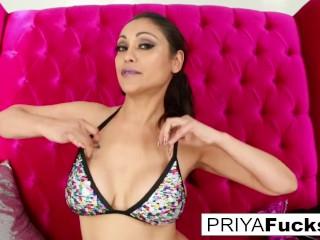 Indian MILF Priya Rai does some fun wardrobe play and self fucking!