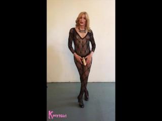 Kacy TGirl Struts in Catsuit with Strap On Dildo