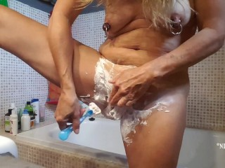 shaving my multiple pierced pussy naked in the bathroom and showing my xxl nipple piercings