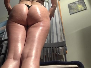 Sexy babe - oiled ass in a thong body suit