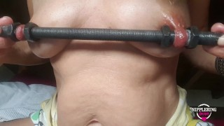 nippleringlover inserting thick rod through huge stretched nipple piercings & riding vibrator PART 2