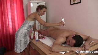 Massage leads to hot granny and boy sex