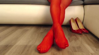 Mistress in beautiful red stockings and red high heels