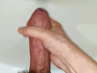 Big cock before taking a bath relaxed and reached orgasm and a lot of cum