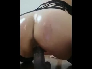 Riding my huge dildo and play with my oily ass and pussy