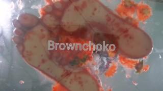 Bare foot food crush Strawberry crush Under glass POV
