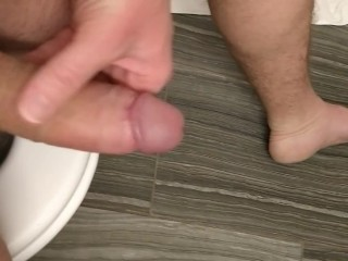 My uncut cock being stroked while I relax on the throne