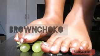 Barefoot fruit crush crushing grapes