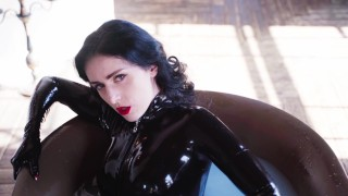 Goddess takes a bath in a latex catsuit