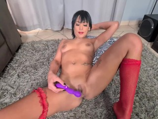 Naught colored girl stripping and playing with her vibrator toy
