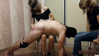 Spanking and handjob from 2 mistresses