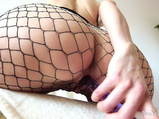 Horny Girl in Fishnet Stockings Fucking Her Wet Pussy with a Glass Dildo