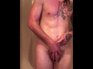 Hot tattooed guy massages his own cock and prostate in shower