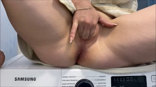 Hot mommy playing with her tight pussy and asshole sitting on the washing machine