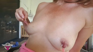 nippleringlover topless outdoors pulling & stretching extreme large gauge nipple piercings with ring