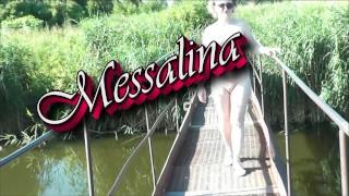 Messalina Dressed in Sun. Outside Outdoor. Nude Milf walks by bridge River. Naturist Nudist Woman