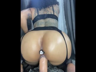 Hot LATINA babe loves riding her toy with butt plug in