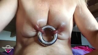 nippleringlover inserting 17mm monster nipple ring in both huge pierced nipples pulling nipples hard