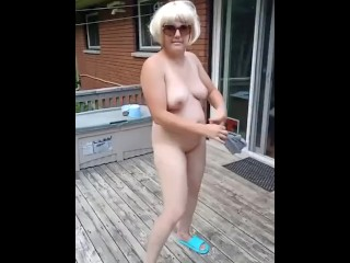 Hot blonde milf strips nude and dances for neighbors