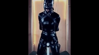 Latex doll in bondage gagged and blindfolded