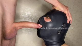 Submissive Teen in Latex Hood Sucking Fat Cock