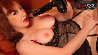 Busty MILF Red XXX plays with her soaking wet pussy