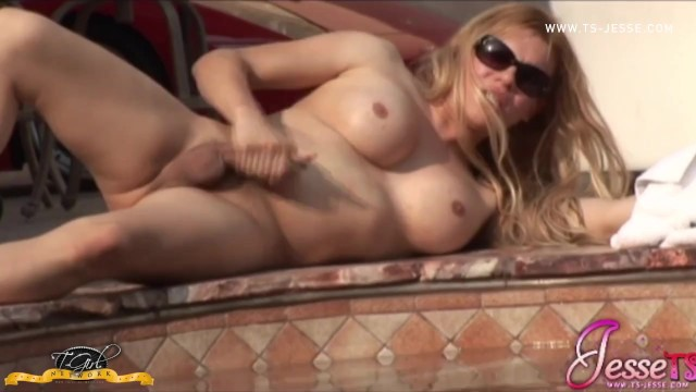 Jesse Strokers Her Massive Tranny Cock by the Pool
