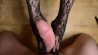 Footjob in black pantyhose with cum on feet