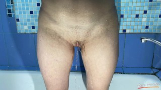 Sexy girl shaves her pussy in the shower