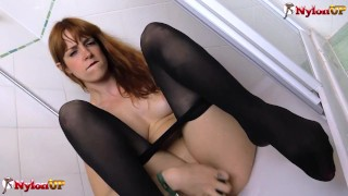Redhead Irina Vega in pantyhose masturbates in the shower