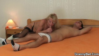 Very old blonde granny rides his young dick
