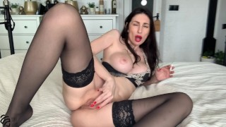 Sexy mom smokes a cigarette and gets an orgasm fucking herself with a dildo.
