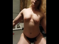 Muscular blonde striptease in home gym Muscular blonde striptease in home gym